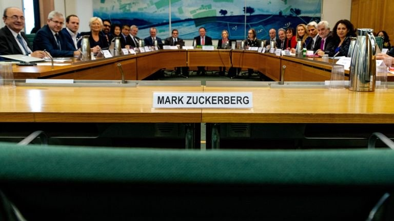 An empty chair with Mark Zuckerberg's name on, at UK Parliament DCMS committee meeting